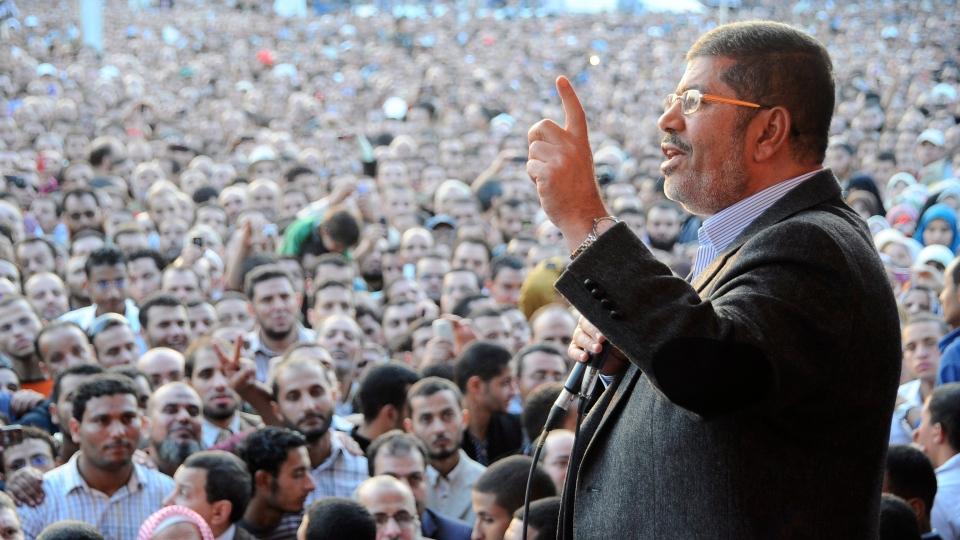 Egyptian President Mohammed Morsi speaks to supporters outside the Presidential palace in Cairo, Egypt on Friday, Nov. 23, 2012. (AP / Egyptian Presidency)