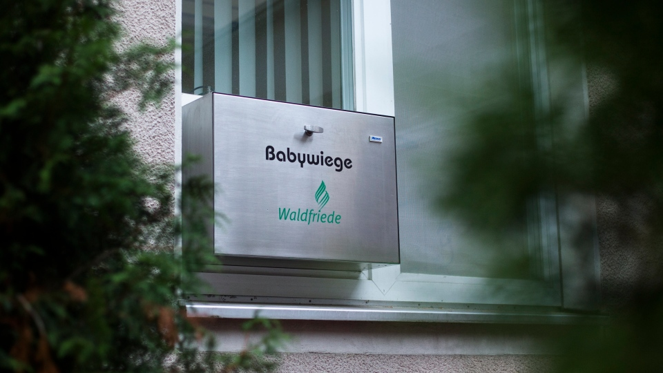 A baby hatch reading baby crib is fixed in a window and hidden by trees at Waldfriede hospital at the district Zehlendorf in Berlin, Wednesday, Nov. 7, 2012. (AP / Markus Schreiber)