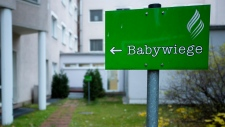 Sign points to a 'baby box' in Berlin, Nov 7, 2012
