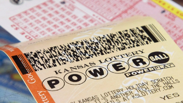 A Powerball form and purchased ticket