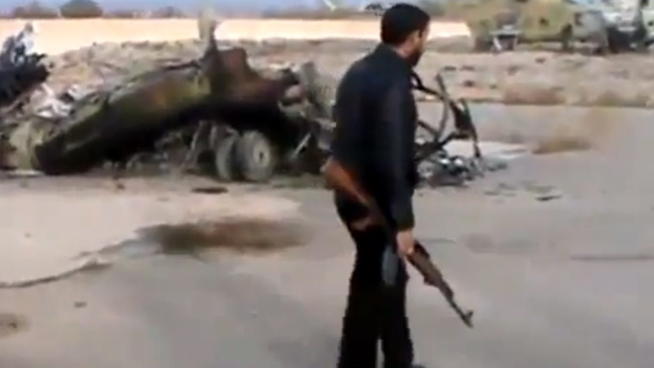 Syrian rebels capture a helicopter air base near the capital Damascus after fierce fighting in Syria, on Sunday, Nov. 25, 2012. (Ugarit News via AP video)