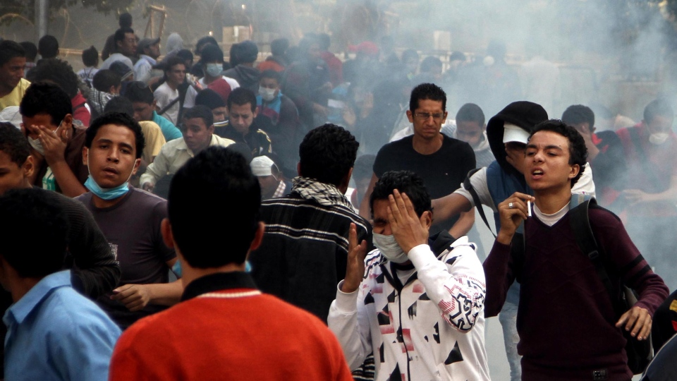Egyptian protesters clash with security forces, not pictured, near Tahrir Square in Cairo, Egypt on Sunday, Nov. 25, 2012. (AP / Ahmed Gomaa)