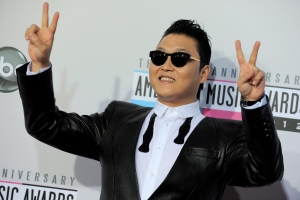 South Korean rapper PSY arrives at the 40th Anniversary American Music Awards in Los Angeles on Sunday, Nov. 18, 2012. (Jordan Strauss / Invision)