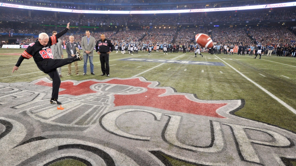 David Johnston, Governor General of Canada, perform a ceremonial kick off before the 100th CFL Grey Cup game between Toronto Argonauts and the Calgary Stampeders in Toronto, Sunday, Nov. 25, 2012. (Nathan Dennett / THE CANADIAN PRESS)