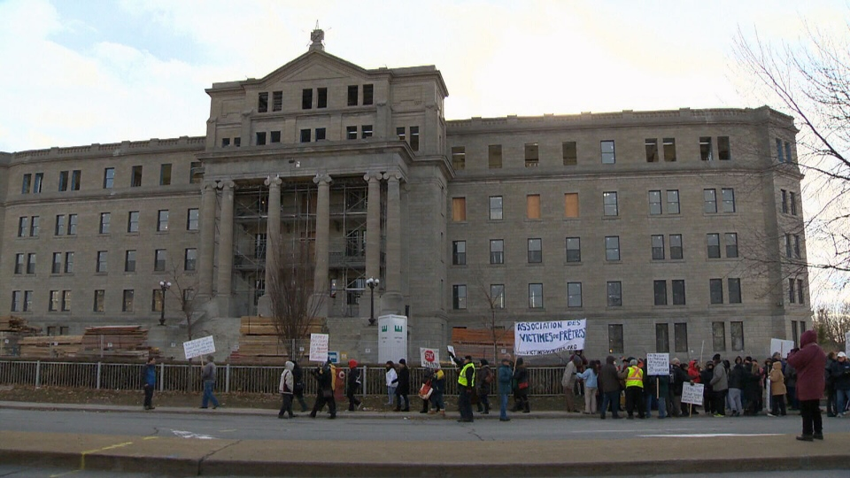 Protesters line the front of the building that used to be a school for the deaf in Montreal on Sunday, Nov. 25, 2012.