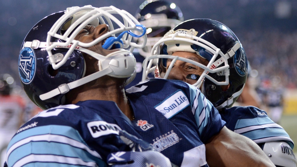 Toronto Argonauts running back Andre Durie celebrates his touchdown against the Calgary Stampeders with teammate Chad Owens during fourth quarter CFL Grey Cup action in Toronto, Sunday, Nov. 25, 2012. (Sean Kilpatrick / THE CANADIAN PRESS)