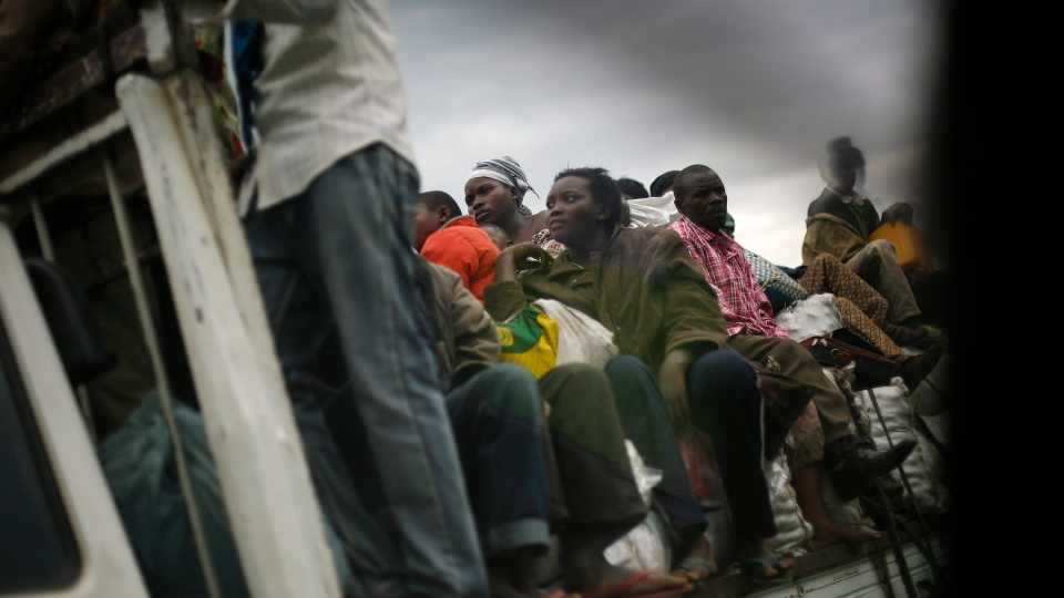 Displaced Congolese return to their homes on the road to Rushuru near Buhumba, some 25 kilometers north of Goma on Thursday, Nov. 22, 2012. (AP Photo/Jerome Delay)