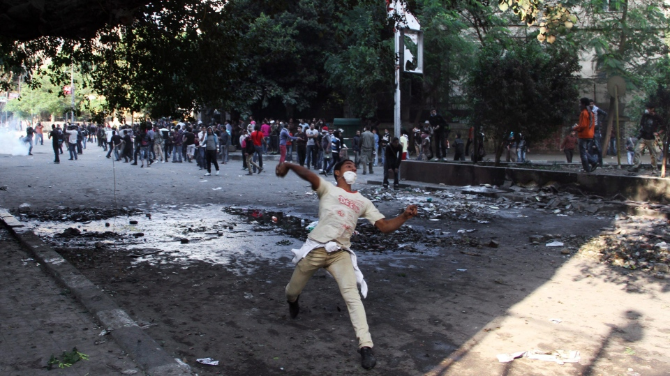 Egyptian protesters clash with security forces, not pictured, near Tahrir Square in Cairo, Egypt, Sunday, Nov. 25, 2012.(AP / Ahmed Gomaa)