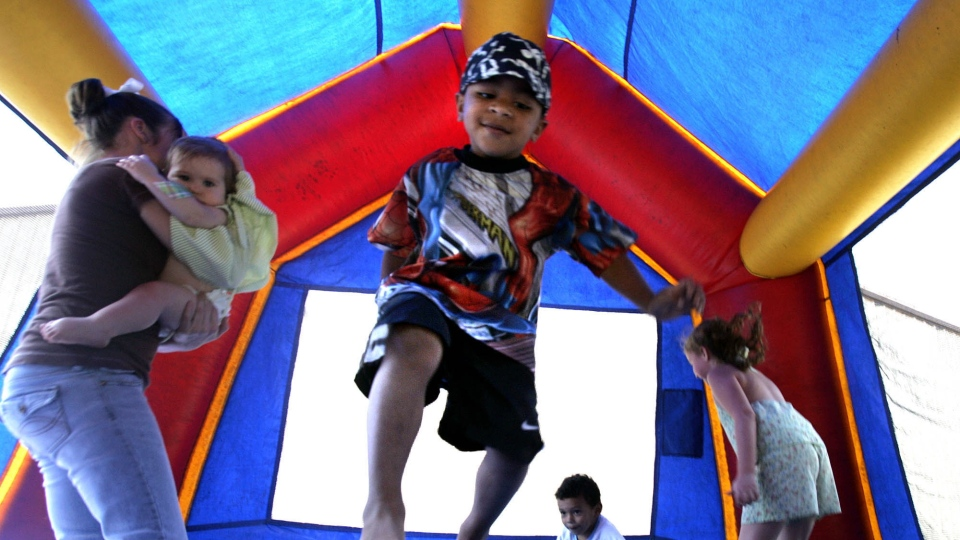 Children play in a bounce house in Vidor, Texas in this 2005 file photo. (AP / LM Otero)