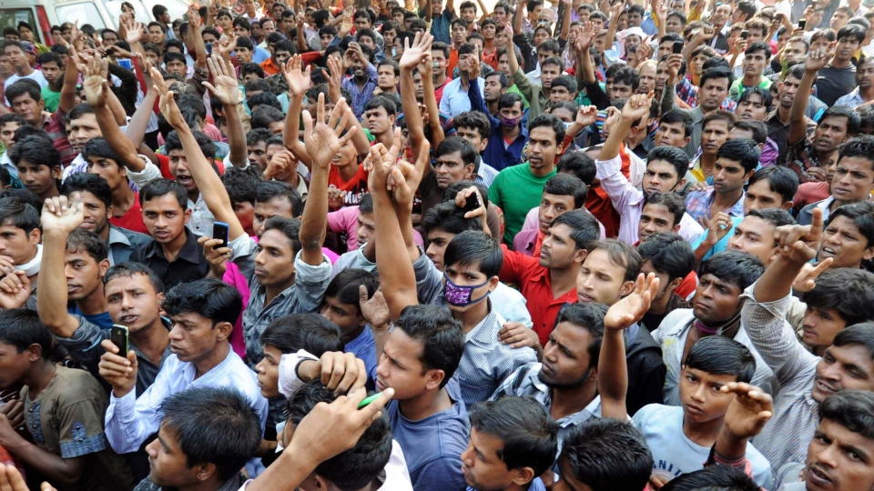 Bangladeshis protest outside a garment-factory where a fire killed more than 110 people Saturday on the outskirts of Dhaka, Bangladesh, Monday, Nov. 26, 2012. (AP Photo)