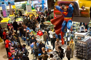 Shoppers wait on a check-out line in the Times Square Toys-R-Us store after doors were opened to the public at 8 p.m. on Thursday. (AP Photo/John Minchillo)