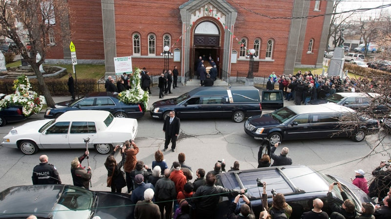 The casket of Nicolo Rizzuto is carried into the church for funeral services for the reputed organized crime boss Monday, Nov. 15, 2010. (Ryan Remiorz / THE CANADIAN PRESS)