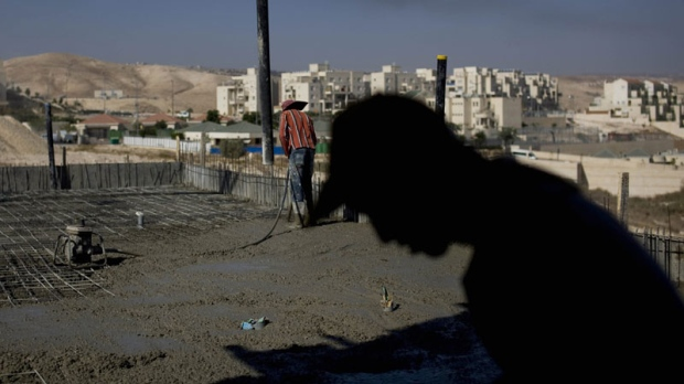 Palestinian men work on a construction site in the West Bank Jewish settlement of Maale Adumim, near Jerusalem, Sunday, Nov. 14, 2010. (AP Photo/Tara Todras-Whitehill)