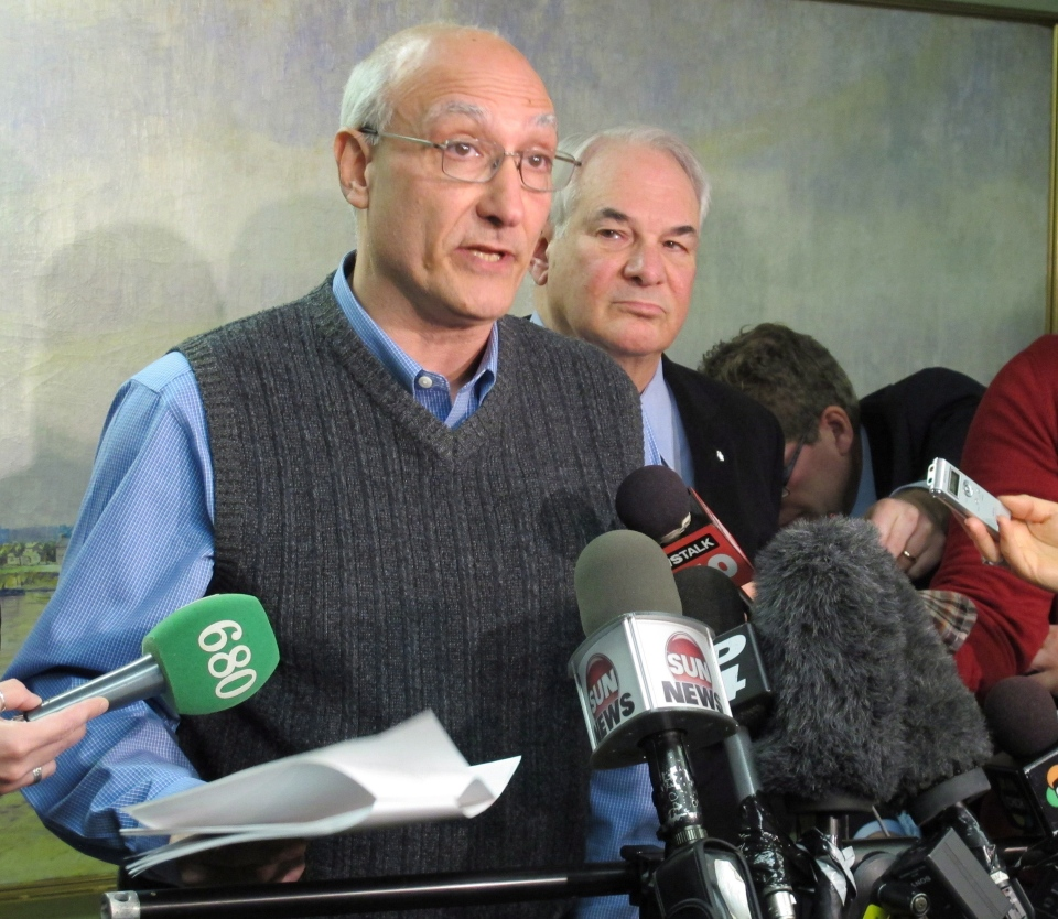 Paul Magder, accompanied by his lawyer Clayton Ruby, speaks at a news conference in Toronto on Monday, Nov. 26, 2012. (Colin Perkel / THE CANADIAN PRESS)
