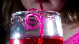 A child drinks from a straw in this September 2012 file photo, one of the known cures for hiccups. (Jonathan Hayward/THE CANADIAN PRESS)