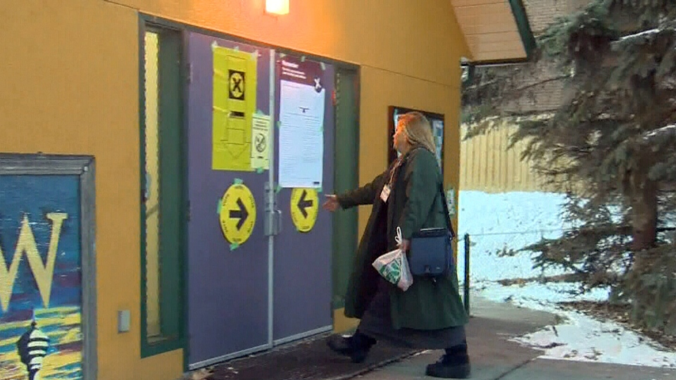 A resident of the Calgary Centre riding enters a polling station on Monday, Nov. 26, 2012.