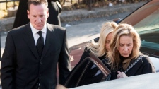 Leonardo Rizzuto, left, and his sister Bettina Rizzuto, right, leave after a funeral service for their grandfather, reputed organized crime boss Nicolo Rizzuto, in Montreal, Monday, November 15, 2010. (Ryan Remiorz / THE CANADIAN PRESS)