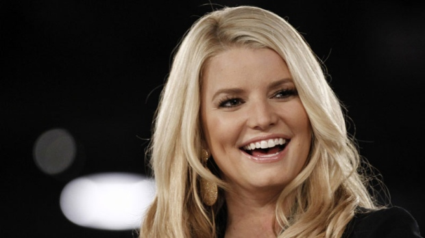 Jessica Simpson speaks onstage at Night at the Village during the Women's Conference in Long Beach, Calif., Monday, Oct. 25, 2010. (AP Photo/Matt Sayles)