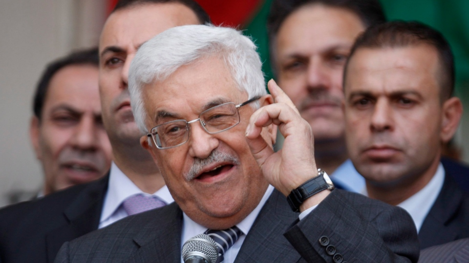 Palestinian President Mahmoud Abbas gestures as he speaks during a rally supporting the Palestinian UN bid for observer state status, in the West Bank city of Ramallah, Sunday, Nov. 25, 2012. (AP / Majdi Mohammed)