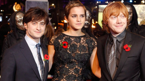 Daniel Radcliffe, Emma Watson and Rupert Grint, from left, arrive at a cinema in London's Leicester Square for the world premiere of 'Harry Potter and the Deathly Hallows: Part 1', Thursday, Nov. 11, 2010. (AP / Joel Ryan)