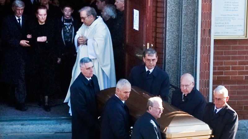 Libertina Rizzuto follows the casket of her husband, Nicolo, from the church after funeral services for reputed organized crime boss Nick Rizzuto, in Montreal on Monday, Nov. 15, 2010. (Ryan Remiorz / THE CANADIAN PRESS)