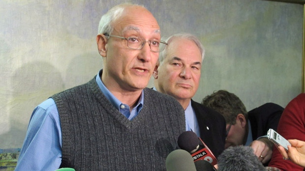 Paul Magder, accompanied by his lawyer Clayton Ruby, speaks at a news conference in Toronto on Monday, Nov. 26, 2012. (The Canadian Press/Colin Perkel)