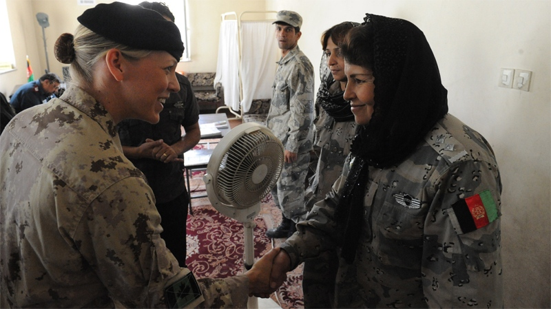Canadian Forces navy Lt. Jennifer Martin, from the NATO Training Mission, helps mentor and advise the Afghan National Security Forces by assisting the small minority of female police within the Afghan Border Police, as seen in this image courtesy the U.S. Army.