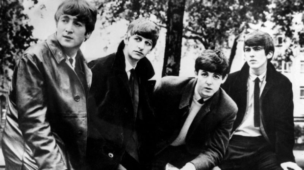 In this undated file photograph British pop band The Beatles, John Lennon (left) Ringo Starr, Paul McCartney and George Harrison (right) pose for a photograph. Apple Inc. said Tuesday, Nov. 16, 2010, its iTunes service will sell music from the Fab Four. (AP)