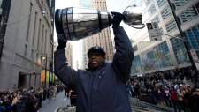 Younger hoists the Grey Cup