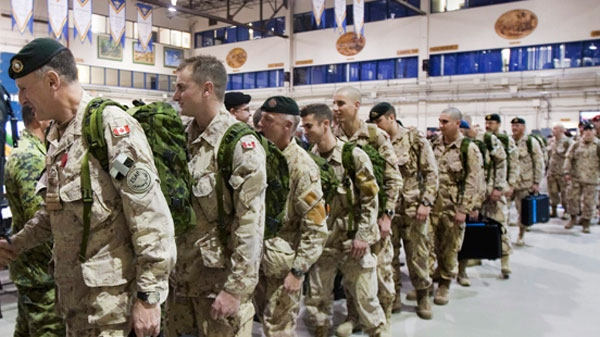 Royal 22nd Regiment soldiers line up in a drill hall as they leave for Afghanistan, at CFB Valcartier, Que., Monday, Nov. 15, 2010 (Jacques Boissinot / THE CANADIAN PRESS)