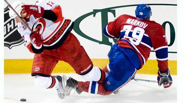 Carolina Hurricanes' Eric Staal, left, collides with Montreal Canadiens' Andrei Markov during third period NHL hockey action in Montreal, Saturday, November 13, 2010. The Canadiens are keeping mum on what could be a serious injury to top defenceman Markov.THE CANADIAN PRESS/Graham Hughes