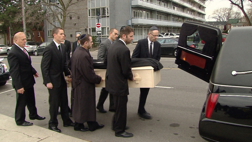 The casket of Tom Samson is placed into the back of a hearse following his funeral service in Toronto on Tuesday, Nov. 27, 2012.