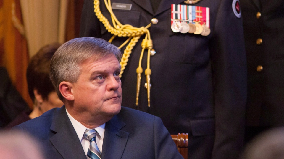 New Brunswick Premier David Alward listens to the reading of the throne speech by Lt.-Gov. Graydon Nicholas in the Legislative Assembly of New Brunswick in Fredericton on November 27, 2012. (Keith Minchin / THE CANADIAN PRESS)