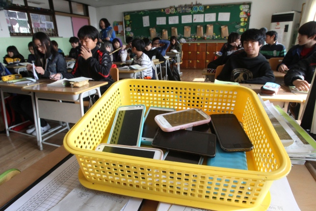 Smartphones in plastic basket South Korea