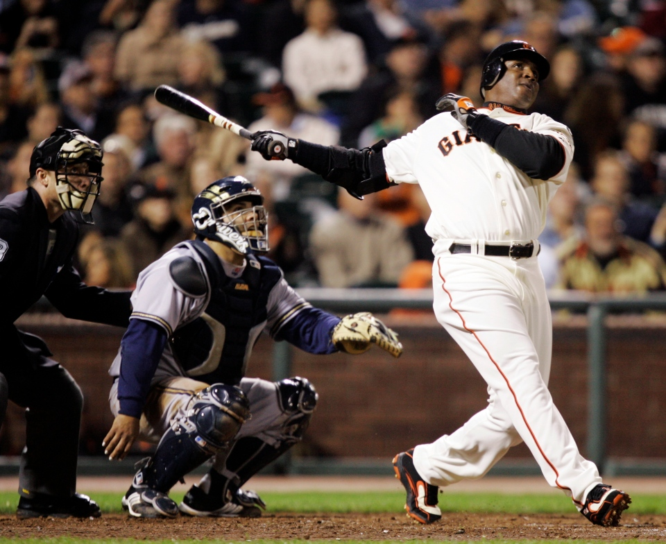 In this Aug. 24, 2007, file photo, San Francisco Giants' Barry Bonds, right, hits his 761st career home run. (AP Photo/Marcio Jose Sanchez, File)