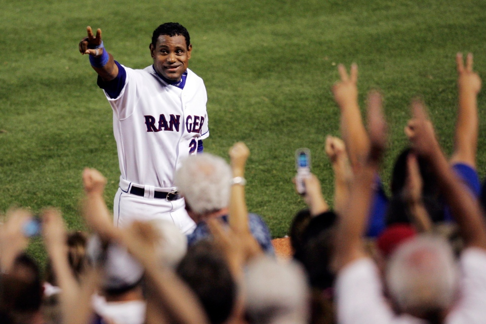 Sammy Sosa acknowledges cheers from fans after hitting his 600th career home run in this 2007 file photo. (AP Photo/Tim Sharp)
