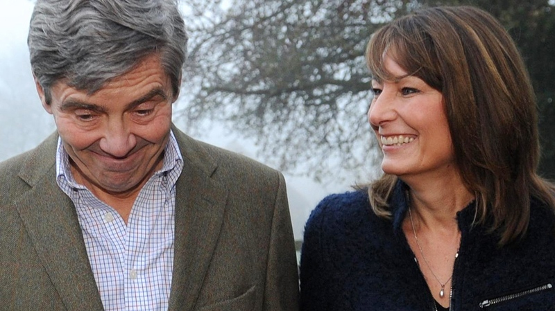 Michael and Carole Middleton, the parents of Kate Middleton, make a statement on the engagement of their daughter to Prince William, outside their home near the village of Bucklebury, England, Tuesday, Nov. 16, 2010. (AP / Stefan Rousseau)