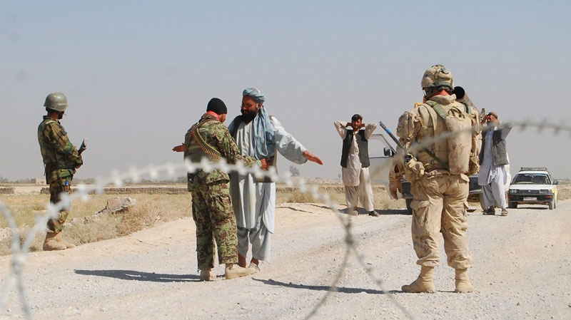 Canadian soldiers establish a checkpoint outside Haji Baba in the Panjwaii district of Kandahar province, Afghanistan, Oct. 19, 2010. (Jonathan Montpetit / THE CANADIAN PRESS)