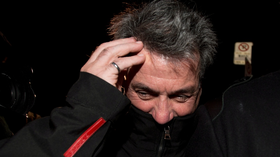Pierre Duhaime leaves SQ headquarters in Montreal on Wednesday, Nov. 28, 2012. (Graham Hughes / THE CANADIAN PRESS)
