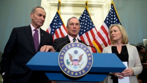 New York City Mayor Michael Bloomberg, centre, flanked by Sen. Charles Schumer, D-N.Y. and Sen. Kirsten Gillibrand, D-N.Y., gestures as he speaks during a news conference on Capitol Hill in Washington, Wednesday, Nov. 28, 2012. (AP / Evan Vucci)