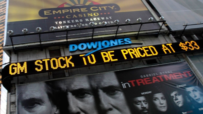 The Dow Jones ticker in Times Square in New York displays news about General Motors stock on Wednesday, Nov. 17, 2010. (AP / Mary Altaffer)