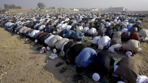 Afghan refugees living in Peshawar, Pakistan, offer Eid al-Adha prayers on Tuesday, Nov. 16, 2010. (AP / Mohammad Sajjad)