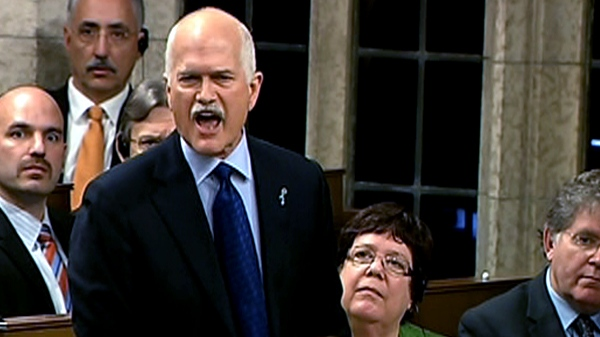 NDP Leader Jack Layton becomes animated while directing a question to Prime Minister Stephen Harper during question period in the House of Commons in Ottawa, Wednesday, Nov. 17, 2010.