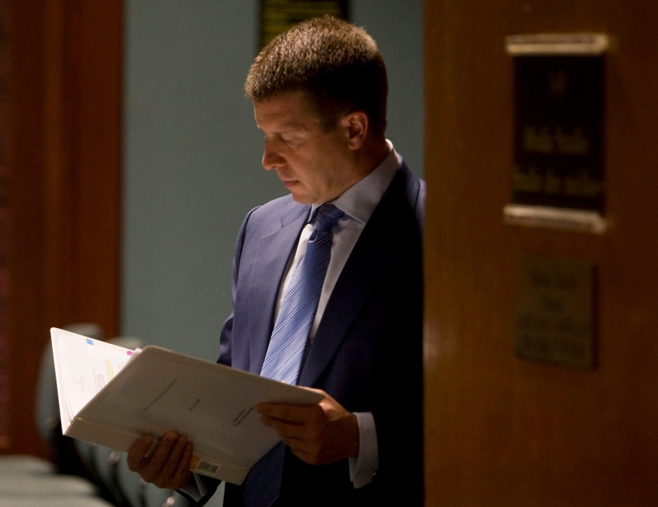 Ontario ombudsman Andre Marin reviews his notes following a news conference in Toronto in this 2008 file photo. (Adrian Wyld/THE CANADIAN PRESS)