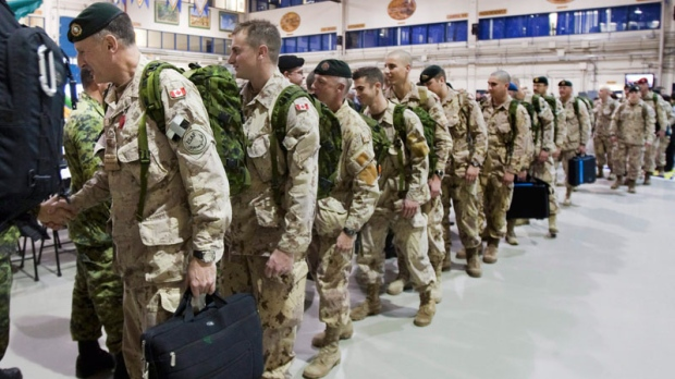 Royal 22nd Regiment soldiers line up in a drill hall as they leave for Afghanistan, Monday, November 15, 2010 at CFB Valcartier, Que. (Jacques Boissinot / THE CANADIAN PRESS)
