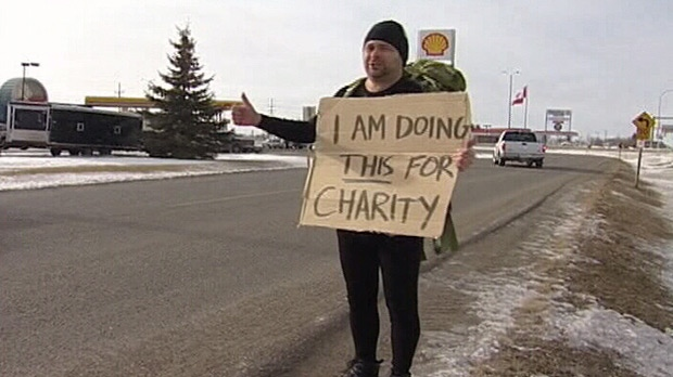 The 'Gitchhiker' is crossing the country in 21 days hoping to raise money for the Canadian Cancer Society.