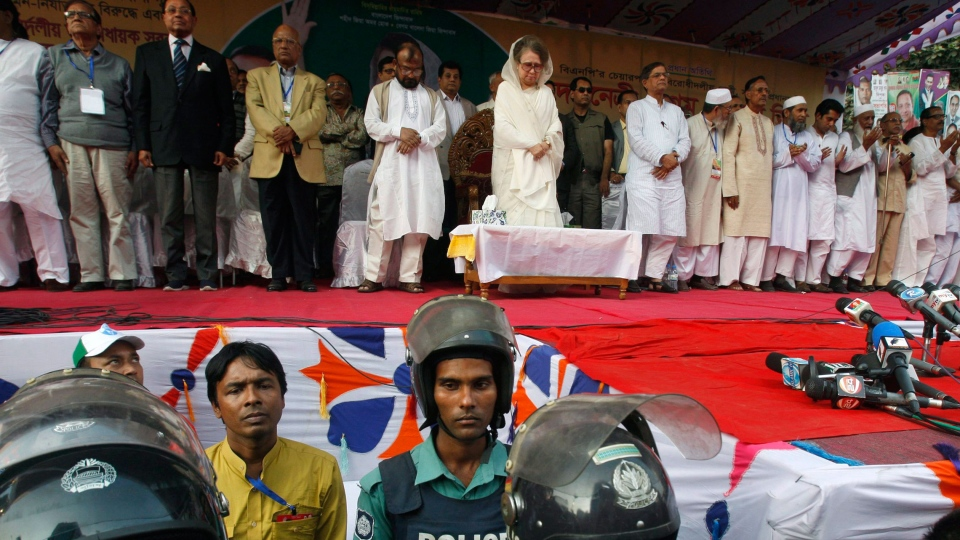 Bangladesh opposition leader and former prime minister Khaleda Zia, background center and others pay tribute to those killed in Saturday's fire at a garment factory during an 18 party alliance meeting in Dhaka, Bangladesh, Wednesday, Nov. 28, 2012. (AP / Pavel Rahman)