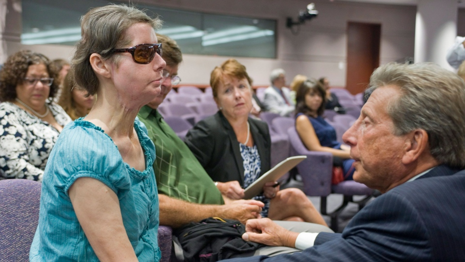 Charla Nash, left, talks with attorney Charles J. Willinger, Jr., right, before a hearing at the Legislative Office Building in Hartford, Conn., Friday, Aug. 10, 2012. (AP / Jessica Hill)