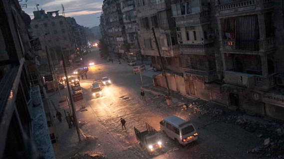 Night falls on a Syrian rebel-controlled area as damaged buildings are seen on Sa'ar street after airstrikes targeted the area, killing dozens, in Aleppo, Syria, Thursday, Nov. 29, 2012. (AP / Narciso Contreras)