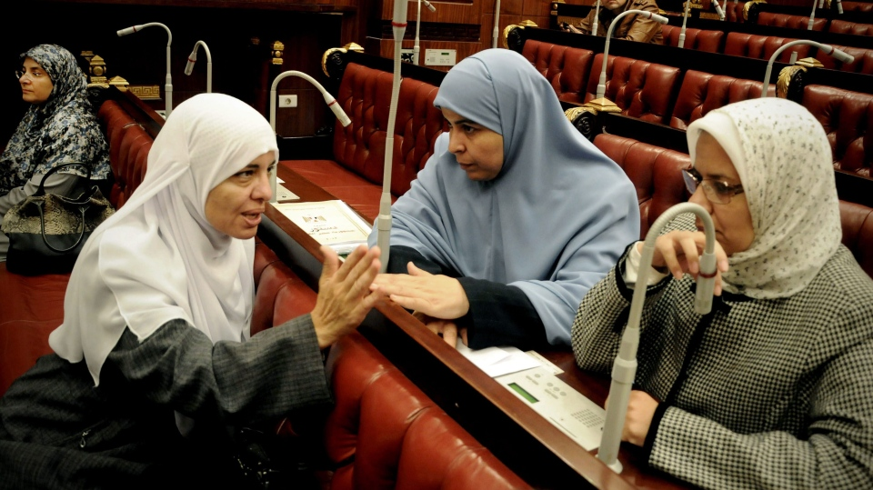 Azza el-Gharf of the Muslim Brotherhood's Freedom and Justice Party, second left, speaks with other members of the assembly during the vote on a final draft of a new Egyptian constitution in Cairo, Egypt, Thursday, Nov. 29, 2012. (AP / Mohammed Asad)